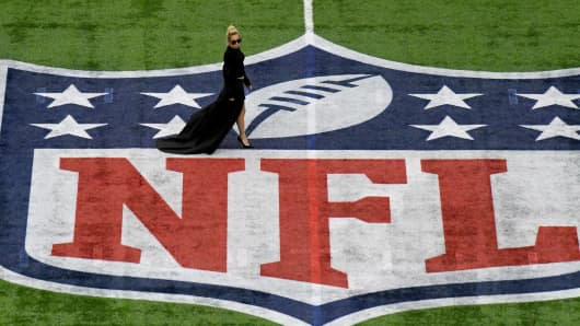 Lady Gaga walks on the field before Super Bowl LI at NRG Stadium.