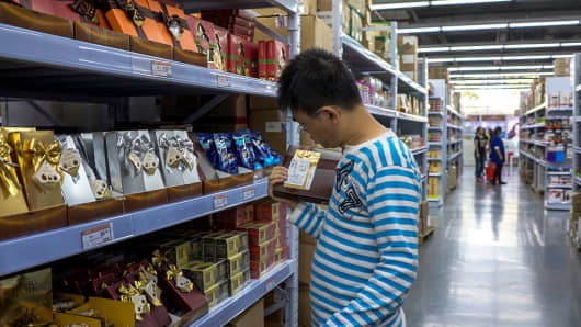 A man choosing chocolates in Shanghai, China.
