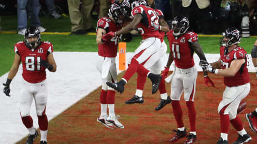 Atlanta Falcons' Devonta Freeman celebrates his second quarter touchdown with teammates.