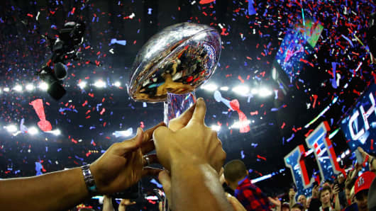 The New England Patriots celebrate with the Vince Lombardi Trophy after defeating the Atlanta Falcons during Super Bowl 51.