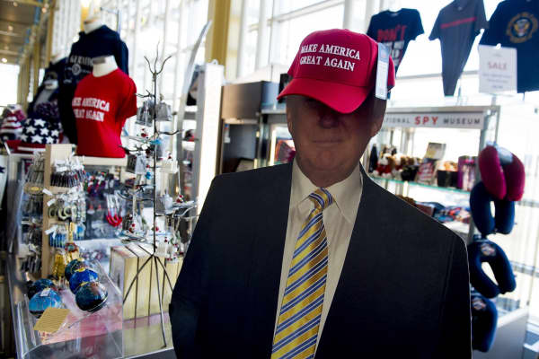 A cutout of US President Donald Trump wearing a 'Make America Great Again' hat is seen at a souvenir shop in the airport terminal at Ronald Reagan Washington National Airport.