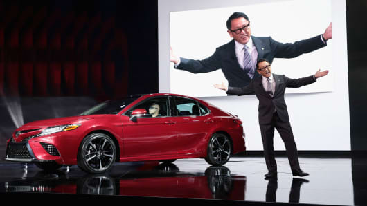 Akio Toyoda, President and member of the board of directors at Toyota, introduces the all-new 2018 Camry at the North American International Auto Show (NAIAS) on January 9, 2017 in Detroit.