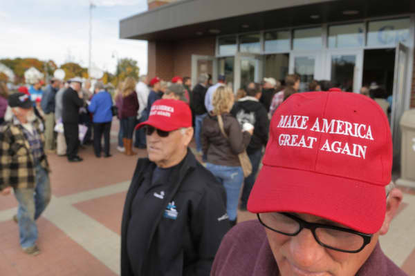 Richard Theriault of Bangor, right, and his father Paul Thriault of Fort Kent wearing Make America Great Again hats.