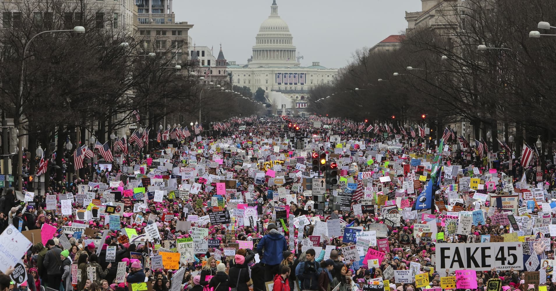 With Capitol Hill in the background a crowd fills the streets on Washington, during the Women's March on January 21, 2017.