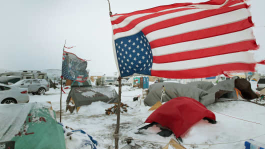 Winds whip across Oceti Sakowin Camp as blizzard conditions grip the area around the Standing Rock Sioux Reservation on December 6, 2016 outside Cannon Ball, North Dakota. Native Americans and activists from around the country have been at the camp for several months trying to halt the construction of the Dakota Access Pipeline. T