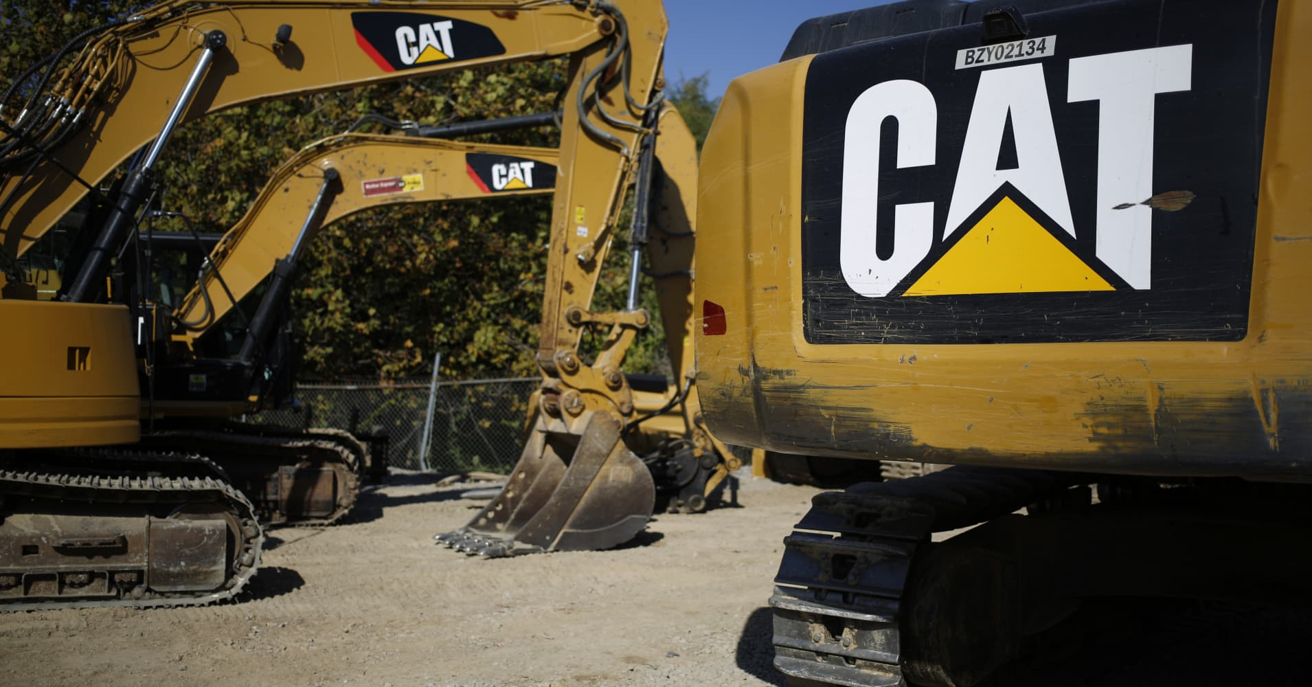 caterpillar smashes expectations raises forecast shares jump