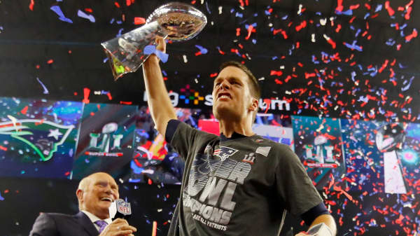 Tom Brady of the New England Patriots celebrates with the Vince Lombardi Trophy after defeating the Atlanta Falcons during Super Bowl 51 at NRG Stadium on February 5, 2017 in Houston, Texas.