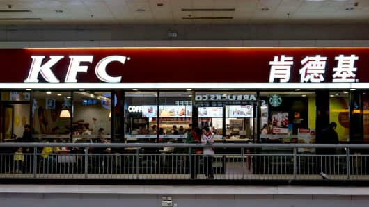 Chinese customers have dinner in a KFC restaurant in Beijing West railway station.