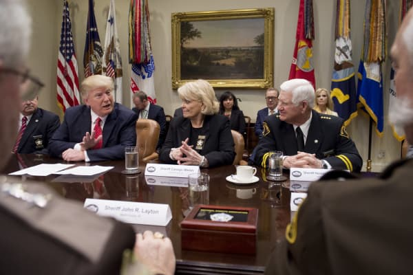 President Donald Trump speaks alongside Sheriff Carolyn Bunny Welsh (C), of Chester County, Pennsylvania, and Sheriff Harold Eavenson (R), of Rockwall County, Texas, during a meeting with county sheriffs in the Roosevelt Room of the White House in Washington, DC, February 7, 2017.