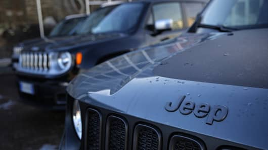 A Jeep logo of Italian-American Fiat Chrysler company is pictured on a car at a car dealer on January 13, 2017 in Turin, northern Italy. The United States on January 12, 2017 charged Fiat Chrysler with using software on its trucks to evade emissions standards on about 104,000 vehicles, an accusation the company immediately denied.
