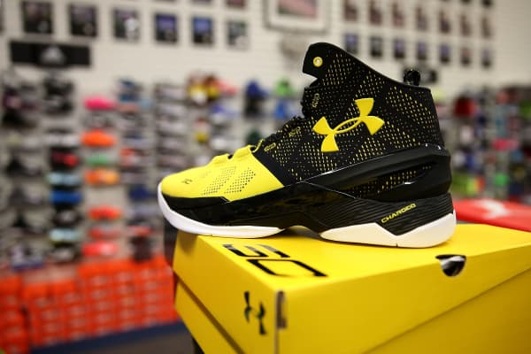 Under Armour sports shoes on display.
