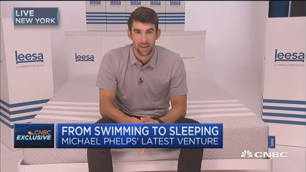 Michael Phelps transitions from swimming to sleeping