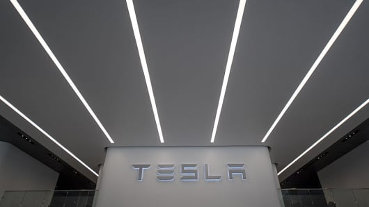 Tesla Motors signage is displayed at the company's new showroom in San Francisco, California, U.S., on Wednesday, Aug. 10, 2016.