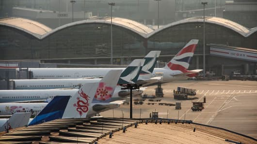 Aircraft sit on the tarmac at Hong Kong International Airport in Hong Kong, China on Mar. 6, 2016.