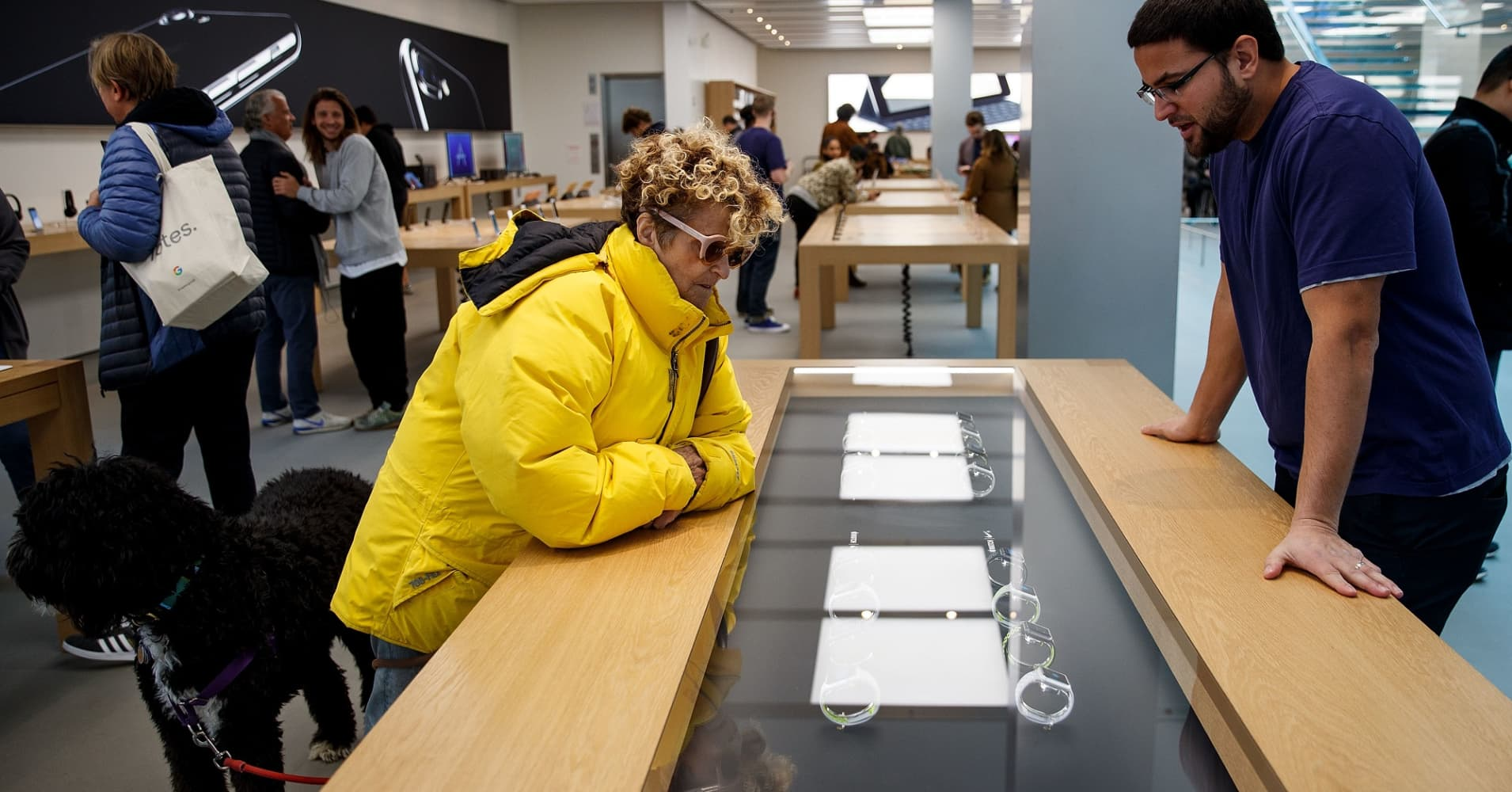 A customer views a display featuring Apple Watch Nike+ at an Apple Store in the SoHo neighborhood of Manhattan.