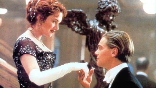 Kate Winslet offers her hand to Leonardo DiCaprio in a scene from the film 'Titanic', 1997. (