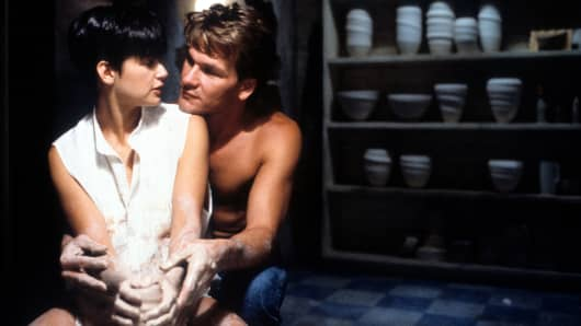 Demi Moore is embraced by Patrick Swayze in a scene from the film 'Ghost', 1990.