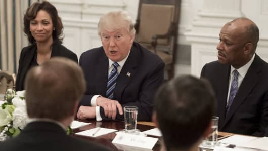 President Donald Trump speaks during a meeting with airline industry executives, including Deborah Flint (L), CEO of Los Angeles World Airports (LAWA); and Myron Gray (R), President of US Operations at UPS, in the State Dining Room of the White House in Washington, February 9, 2017.