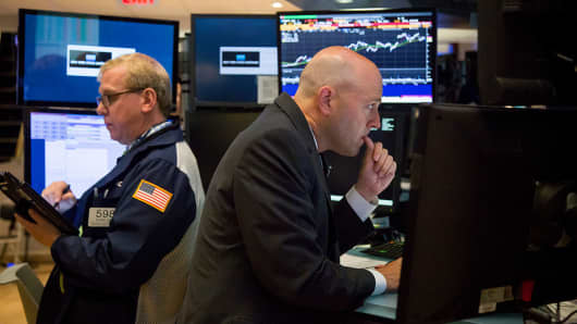 Traders work on the floor of the New York Stock Exchange (NYSE) in New York, U.S.