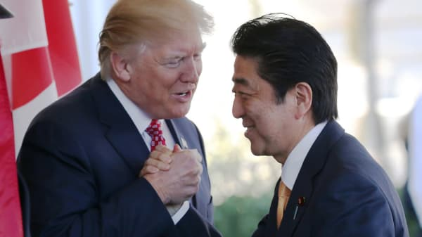 President Donald Trump (L) greets Japanese Prime Minister Shinzo Abe as he arrives at the White House on February 10, 2017 in Washington, DC.