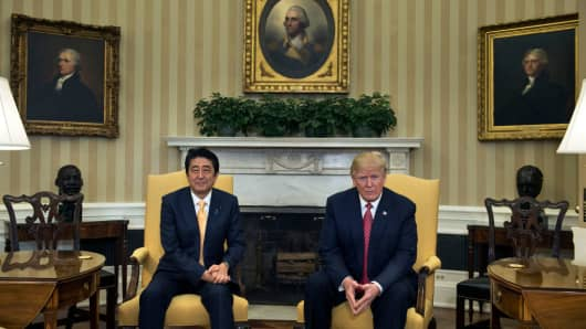 Japan's Prime Minister Shinzo Abe and US President Donald Trump await a gathering within the Oval Dwelling of job of the White Residence on February 10, 2017 in Washington, DC.