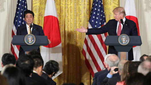 U.S. President Donald Trump (R) holds a joint press conference with Japan Prime Minister Shinzo Abe in the East Room at the White House on February 10, 2017 in Washington, DC.
