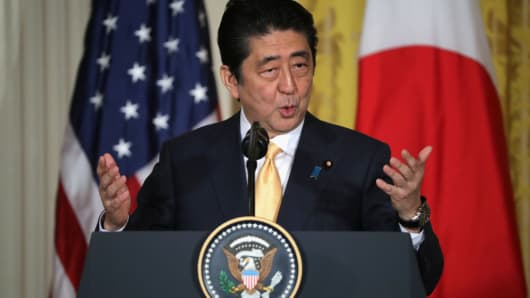 Japanese PM Shinzo Abe speaks during a press conference with President Donald Trump at the White House on February 10, 2017 in Washington, DC.
