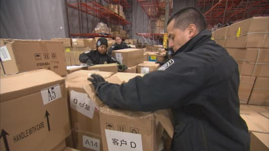 Government agents inspect a shipment from China