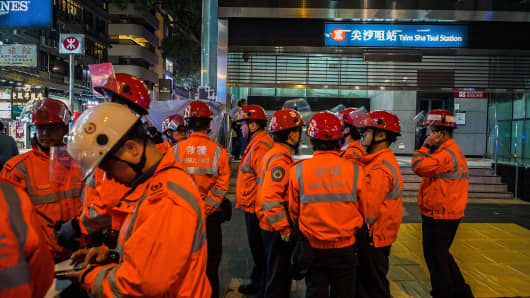Paramedics standby at Tsim Sha Tsui MTR station on February 10, 2017 in Hong Kong. A 60 year-old man set a fire with a fuel-filled bottle as the train was halfway between Admiralty and Tsim Sha Tsui stations.
