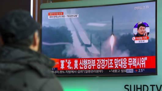 A man watches the news showing file footage of North Korea's missile launch at a railway station in Seoul on February 12, 2017.