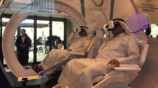 Visitors try out the Mars 2117 virtual reality experience at the World Government Summit in Dubai on February 2, 2017.
