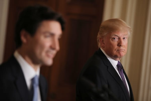 President Donald Trump (R) listens to Canadian Prime Minister Justin Trudeau during a joint news conference at the White House in Washington, U.S., February 13, 2017.
