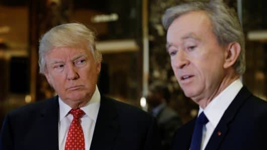 President-elect Donald Trump looks on as LVMH Chairman and Chief Executive Officer Bernard Arnault speaks to reporters after their meeting at Trump Tower in New York, U.S., January 9, 2017.