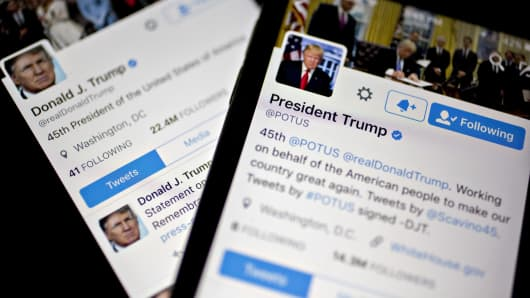 The Twitter Inc. accounts of U.S. President Donald Trump, @POTUS and @realDoanldTrump, are seen on an Apple Inc. iPhone arranged for a photograph in Washington, D.C.