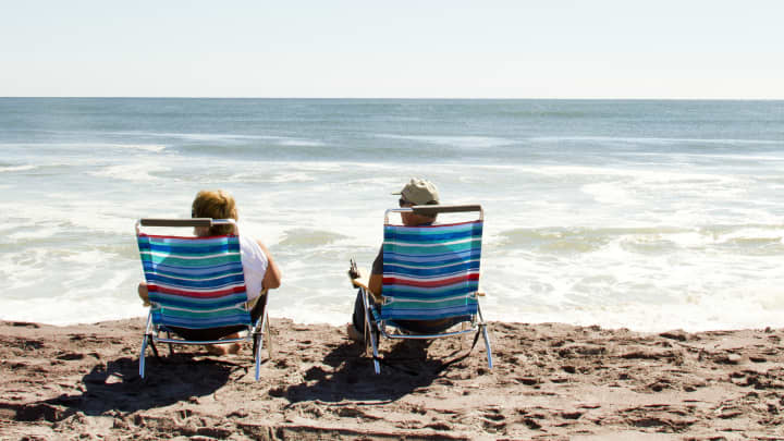 Retirees on a beach, retired, vacation