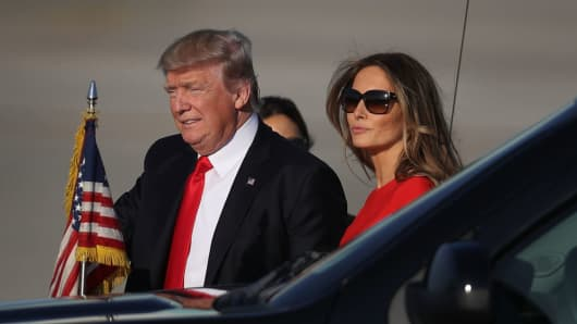 U.S. President Donald Trump walks with first lady Melania Trump