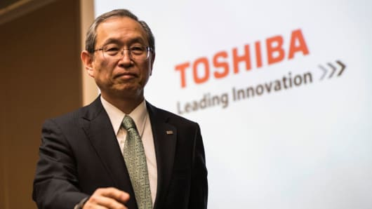 Toshiba President Satoshi Tsunakawa leaves after a press conference at the company's headquarters in Tokyo on February 14, 2017.
