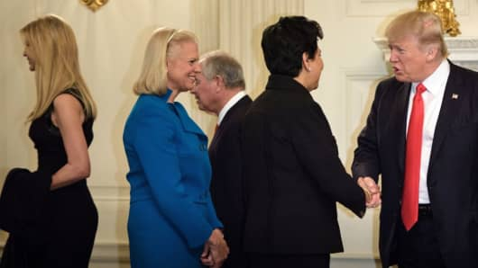Ivanka Trump (L), Ginni Rometty (2ndL), CEO of IBM, Indra Nooyi (2ndR), CEO of Pepsi Co., and US President Donald Trump (R) arrive for a policy and strategy forum with executives in the State Dining Room of the White House February 3, 2017 in Washington, DC