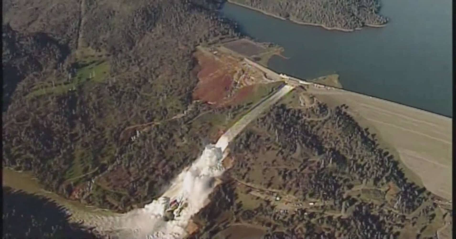 Water rushes over damaged primary spillway at Oroville Dam in Northern California in photo taken in