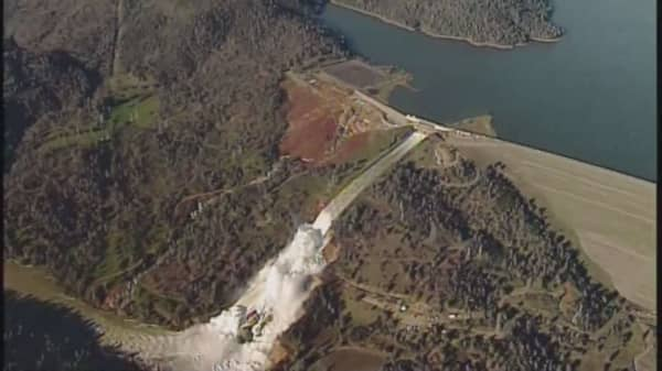Water rushes over damaged primary spillway at Oroville Dam in Northern California in photo taken in February.