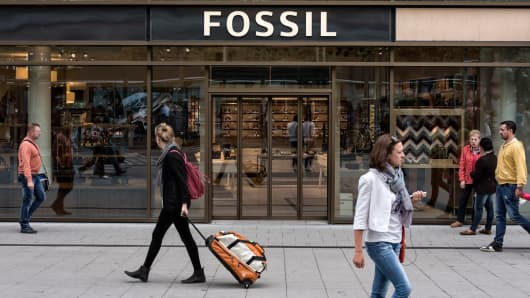 Shoppers walk by Fossil store in Zeil, Frankfurt, Germany.