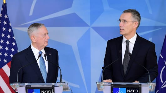 NATO Secretary General Jens Stoltenberg (R) and US Defence Minister James Mattis address the press during a NATO defense ministers' meeting at the NATO headquarters in Brussels on February 15, 2017.