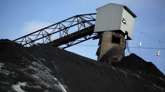 A coaling tower stands above a mound of coal at the Arch Coal Sentinel Prep Plant in Philippi, West Virginia.