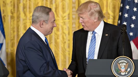 President Donald Trump, right, shakes hands with Benjamin Netanyahu, Israel's prime minister, during a news conference in the East Room of the White House in Washington, on Wednesday, Feb. 15, 2017.