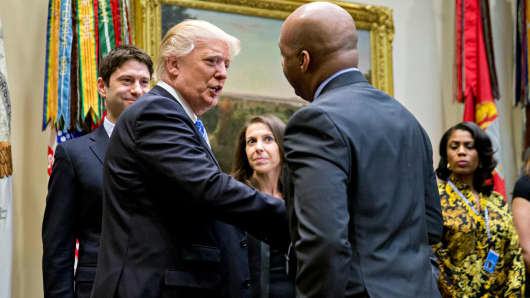 President Donald Trump shakes hands with Marvin Ellison, Chairman and Chief Executive Officer of J.C. Penny Co. during a listening session with the Retail Industry Leaders Association and member company chief executive officers in the Roosevelt Room of the White House on February 15, 2017 in Washington, D.C.
