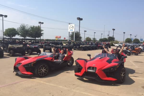 Salinas and Riess in their Polaris Slingshots.
