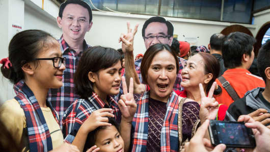 Supporters of Basuki Tjahaja Purnama, commonly known as Ahok, take a selfie with a cardboard cutout during the voting on February 15, 2017 in Jakarta, Indonesia.