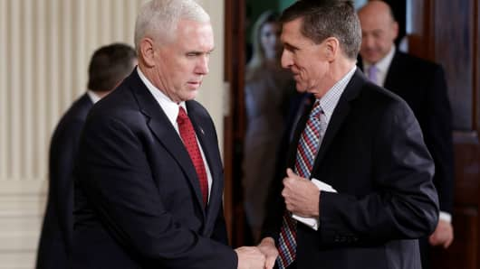 Vice President Mike Pence greets National Security Advisor Michael Flynn at the White House on February 10, 2017. One day earlier, Pence had learned he was kept in the dark about Flynn's contacts with the Russian ambassador.