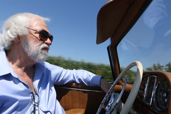 Rob Myers cruises in a beautifully restored Mercedes-Benz 300SL Roadster worth over $1 million.