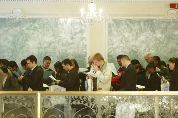 Job applicants line up to get into a job fair.